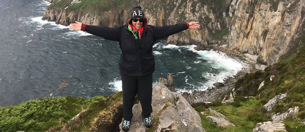 student studying abroad in Ireland by sea cliff